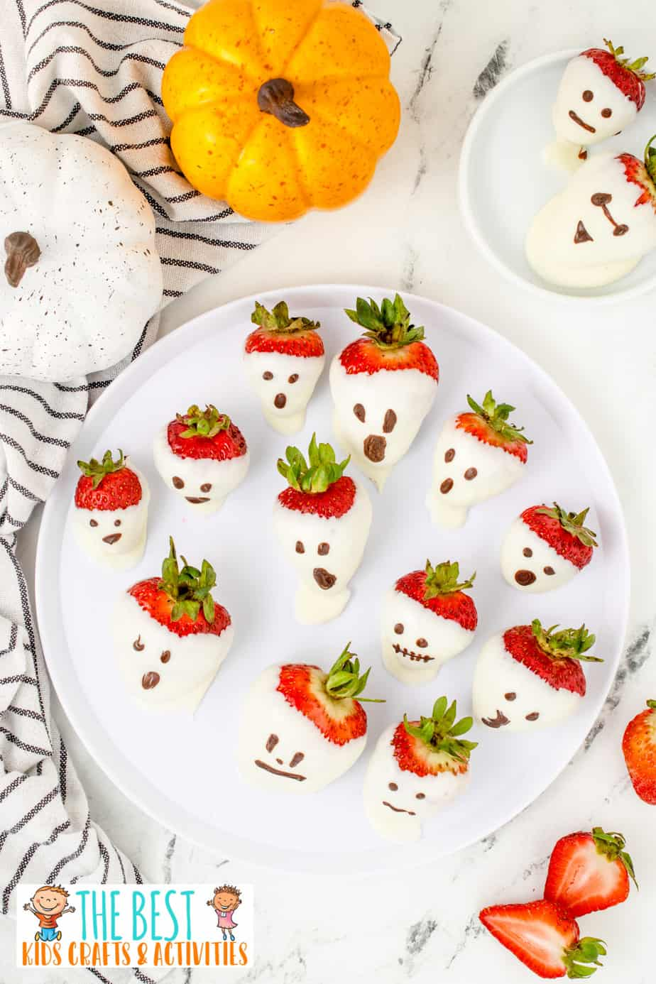 ghost strawberries made with white chocolate on a platter