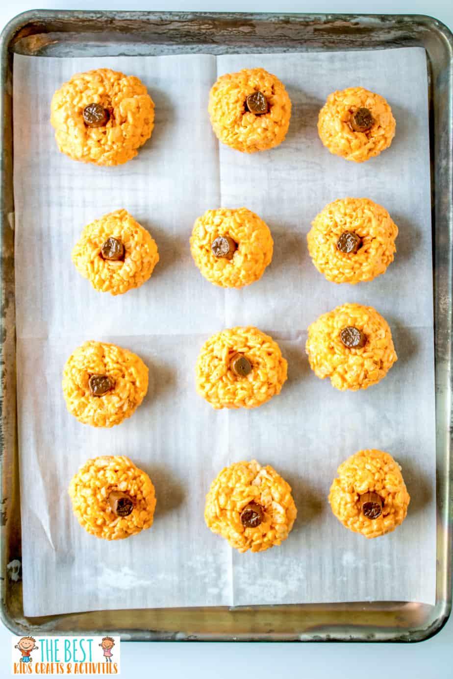 Pumpkin rice krispie treats on a baking sheet